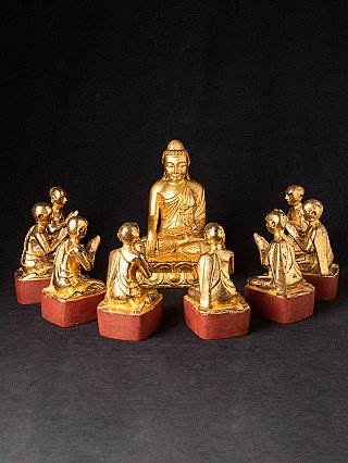 Antique set of 8 monks with Buddha statue