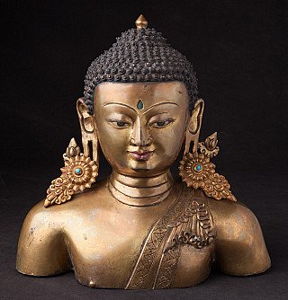 Old bronze Nepali Buddha head
